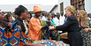 Hillary Clinton purchases goods from local merchants in the Democratic Republic of Congo. Photo Credit: REUTERS